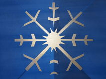 Snowflake blue paper carved in backlit Stock Images