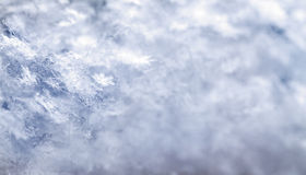 Snowflake in blue snow Stock Photos