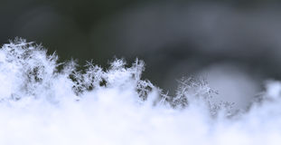Snowflake in blue snow Royalty Free Stock Images