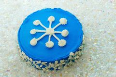 Snowflake Cake on Artificial Snow Stock Photo