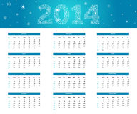 2014 snowflake calendar. 2014 calendar in cold style - blue with snowflakes Stock Photos