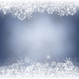 Snowflake card. Winter background. Borders made of fluffy snowflakes on soft blue background with space for text Stock Image