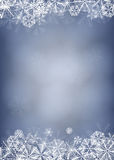 Snowflake card. Winter background. Borders made of fluffy snowflakes on soft blue background with space for text Royalty Free Stock Images