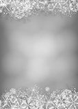 Snowflake card. Winter background. Borders made of fluffy snowflakes on soft gray background with space for text Stock Images