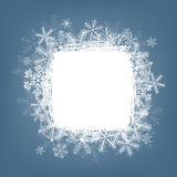 Snowflake card. Winter background. Frame made of fluffy snowflakes on soft blue background with space for text Royalty Free Stock Photography