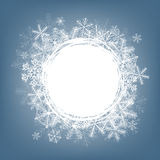 Snowflake card. Winter background. Frame made of fluffy snowflakes on soft blue background with space for text Stock Image