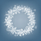 Snowflake card. Winter background. Frame made of fluffy snowflakes on soft blue background with space for text Royalty Free Stock Photo