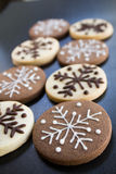 Snowflake christmas Cookie. S white and dark with dark background, dessert Royalty Free Stock Image