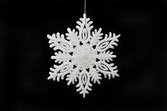 Snowflake Christmas decoration. Isolated against black Royalty Free Stock Photography
