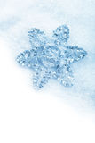 Snowflake christmas decoration in white snow isolated Royalty Free Stock Photo