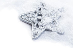 Snowflake christmas decoration in white snow Stock Images