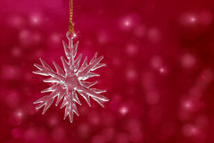 Snowflake Christmas ornament on red background Royalty Free Stock Photography
