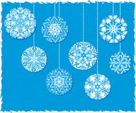 Snowflake Christmas Ornaments on a Blue Background Royalty Free Stock Photography