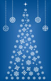 Snowflake Christmas tree. Christmas tree made up of snowflakes and diamond shapes surrounded by ornaments Royalty Free Stock Images