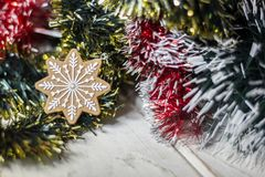 Snowflake on the christmas tree as holyday decoration. Snowflake on the christmas tree as holyday decoration Royalty Free Stock Image