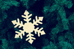 Snowflake on Christmas tree Stock Photo