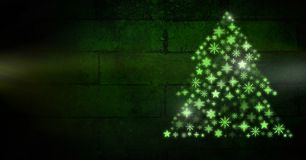 Snowflake Christmas tree pattern shape glowing green. Digital composite of Snowflake Christmas tree pattern shape glowing green stock illustration