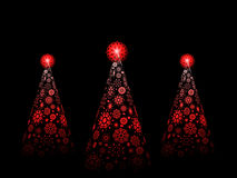 Snowflake Christmas trees. Three red snowflake Christmas trees with red stars on a black background Royalty Free Stock Images