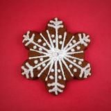 Snowflake Cookie. On red background stock photography