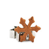 Snowflake cookie and metal cutter Stock Image