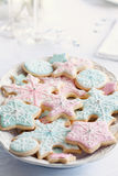 Snowflake cookies. Piink, blue and white snowflake shaped cookies Royalty Free Stock Photos