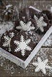 Snowflake cookies. Snowflake, chocolate, Christmas cookies on old wood table Stock Images