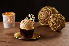 Snowflake cupcake on Christmas background. Snowflake cupcake on black Christmas background Royalty Free Stock Photo