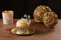 Snowflake cupcake on Christmas background. Snowflake cupcake on black Christmas background Stock Photos