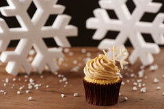 Snowflake cupcake on Christmas background. Snowflake cupcake on white snow flakes Christmas background Royalty Free Stock Images