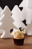 Snowflake cupcake on Christmas background Royalty Free Stock Image