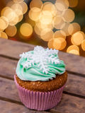 Snowflake cupcake. On winter holidays stock photography