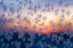 Snowflake and daybreak. Out of window Royalty Free Stock Photography
