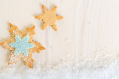 Snowflake decorated cookies background Stock Images