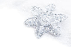 Snowflake decoration in white snow isolated Royalty Free Stock Photos