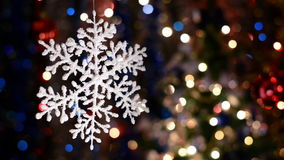 Snowflake decorations, bokeh background, out of focus lights, Christmas and Happy New Year defocused abstract background. Very shallow deep of field stock video footage