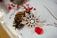Snowflake. A decorative snowflake with pine cone Royalty Free Stock Image