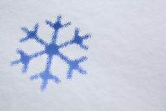 Snowflake design on snowy  background Royalty Free Stock Photos