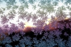 Snowflake on the glass. A snowflake is a single ice crystal that has achieved a sufficient size, and may have amalgamated with others, then falls through the royalty free stock image
