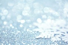 Snowflake on glitter. Winter background stock photography