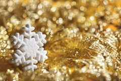 Snowflake Golden Background, Sparkling Snow Flakes Decoration. Over Defocused Lights Royalty Free Stock Photos