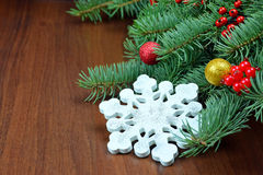 Snowflake hand-made on the branches of a Christmas tree. Royalty Free Stock Image