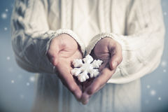 Snowflake in hands. Winter and Christmas concept. Hands close-up holding a snowflake Stock Photos