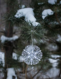 Snowflake hanging on a string. Macro photo. Royalty Free Stock Images