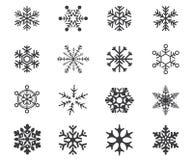 Snowflake icon set on a white background. Multiple shape and sized snowflake icon set for winter designs on a white background in flat style Royalty Free Stock Photos