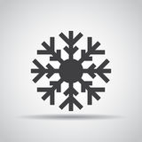 Snowflake icon with shadow on a gray background. Vector illustration Royalty Free Stock Photos