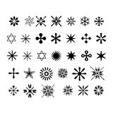 Snowflake Icons. A selection of 35 different Symmetrical snowflakes icons. Black over a pure white background Stock Photos