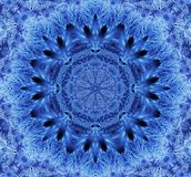 Snowflake kaleidoscope. Blue white frost design stock images