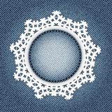 Snowflake lace on denim Royalty Free Stock Photography