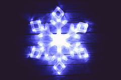 Snowflake LED. A blue LED snowflake Christmas decoration shined brightly during the night Stock Images