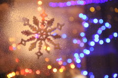 Snowflake. And lights on the window Stock Photo